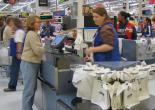 A Walmart worker at the checkout line