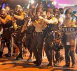 Police on the move during charges against protesters in Ferguson