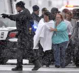 Victims of the terror at a Planned Parenthood clinic are led past police lines
