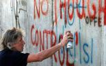 Roger Waters adding his lyrics to the protest art on Israel's apartheid wall
