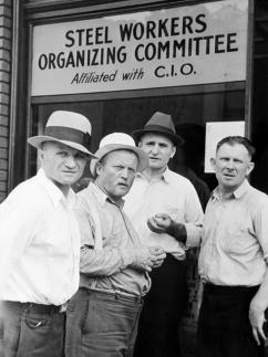 Pennsylvania members of the Steel Workers Organizing Committee in front of their office