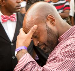 A relative of Mike Brown arrives at the funeral (Brett Myer | Youth Radio)