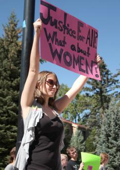 A student protests Justice for All at a Colorado campus