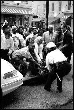 Protesters attempt to defend a fellow marcher from police during the protests in Cincinnati in 2001 (Ryan Thomas)