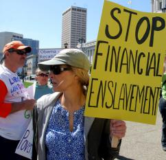 "A woman in Gucci sunglasses protests her ""enslavement"" by taxation (Steve Rhodes)"