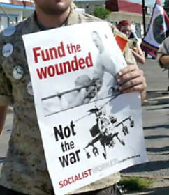 Protesters organized by Iraq Veterans Against War march outside Fort Hood in July (Madeleine Dubus)