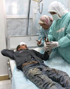 A 14-year-old boy injured by Qaddafi's forces outside of Brega (Al Jazeera)
