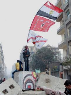 A Zamalek ultra joins in street battles in Cairo during protests about the Port Said massacre (Bora S. Kamel)