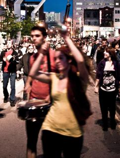 Students join in a caserole march through Montreal, banging on pots and pans