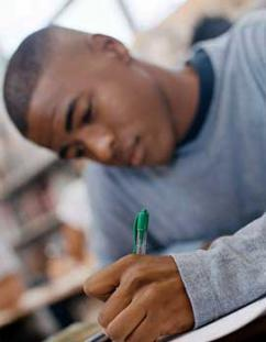 A student works on the GED test