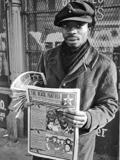 A member of the Black Panther Party sells copies of its widely read newspaper