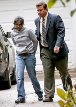 Annie Dookhan being arrested at her home