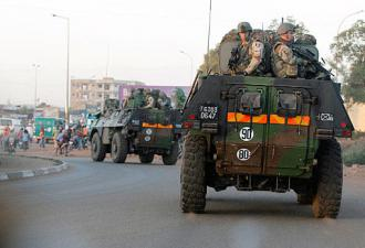 A convoy of French troops move through the streets of Bamako
