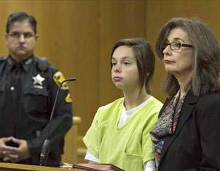 Cassidy Goodson (center) appears in court