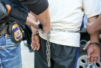 Immigration and Customs Enforcement agents prepare to transfer a detainee