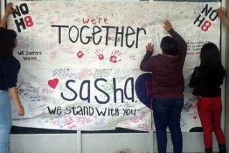 Students in Oakland sign a poster for Sasha