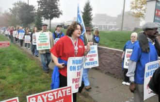 Donna Stern (center, in red) joins other nurses on the picket line