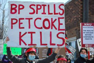 Chicagoans march against a recent BP oil spill and piles of deadly petcoke stored on the South Side (Carole Ramsden)