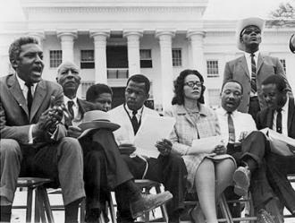 Civil rights leaders at the 1965 Selma to Montgomery march. Bayard Rustin and A. Philip Randolph are seated at left; Martin Luther KIng is second from the right (Jack T. Franklin Photography Collection)