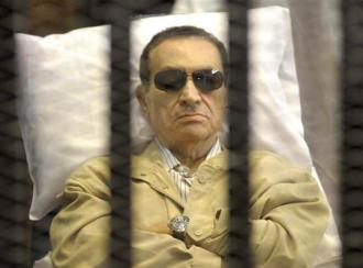 Hosni Mubarak in court as the verdict in his case is read