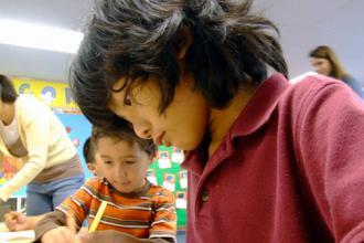 Kindergarten students focus on desk work