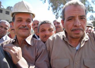 Workers at the Tora Cement factory celebrate after a successful sit-in over pay and conditions in 2009 (Sarah Carr)