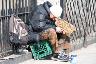 A man left homeless during the housing market crash sits at Broadway and 79th (Ed Yourdon)