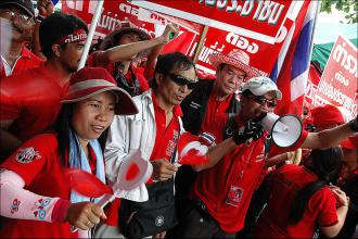 Red Shirt protesters outside the Government House in Bangkok