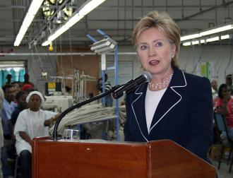 Hillary Clinton celebrates job creation in Haiti inside a clothing factory