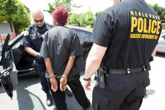 A man is seized and arrested by narcotics officers in California