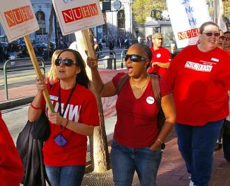 Members and supporters of the National Union of Healthcare Workers picket for home care workers in San Francisco (NUHW)