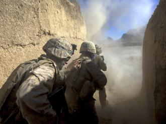 Marines take cover as their explosives burst open an Afghan home in Farah Province (David Furst)