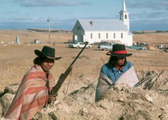 Two AIM activists stand guard during the occupation of Wounded Knee
