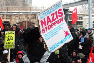Participants in the No Pasaran protest stand up to Nazis in Dresden