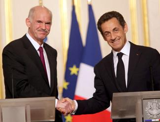 Greek Prime Minister George Papandreou shaking hands with French president Nicholas Sarkozy