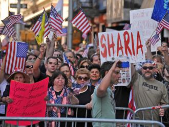 Anti-Muslim protesters demonstrate against the proposed Islamic cultural center in New York City