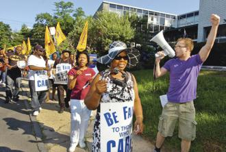 Striking workers at Westport Health Care Center on the march earlier this summer
