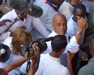 Haitian Presdent Michel Martelly surrounded by the media (Rozanna Fang)