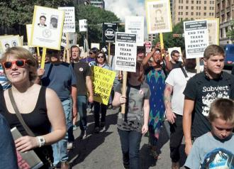 Protesters join in the 13th annual March to Abolish the Death Penalty in Austin, Texas
