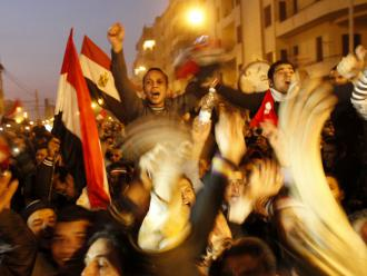 Masses of people fill Tahrir Square, cheering the fall of dictator Hosni Mubarak