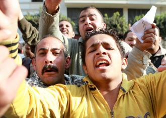 Egyptian Telecom workers rejoice after Mubarak is forced to step down  (Sarah Carr)