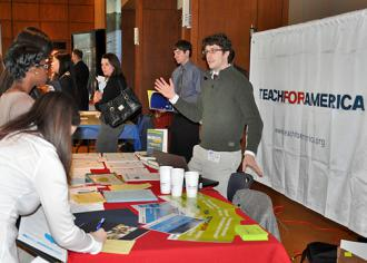 A Teach for America recruiter at a career fair at Penn State