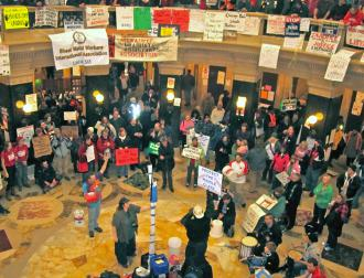 A crowd gathers in the Wisconsin Capitol rotunda to hear speakers talk on the people's mic (Angela Payne)