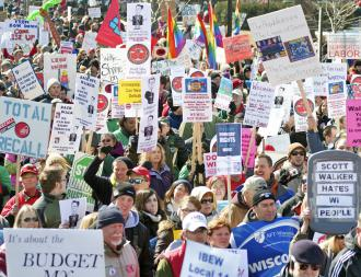 Workers and supporters from across the Midwest marched in Madison after Walker signed the union-busting law (Ken Fager)