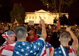 Crowds celebrate outside the White House as Barack Obama announces the killing of Osama bin Laden