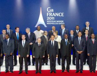 Top officials pose at 2011's G8 summit in France