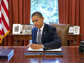 Barack Obama signs last summer's Budget Control Act (Pete Souza)