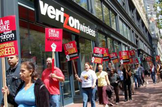 Workers picket outside a Verizon store in New York last August