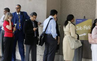 Job seekers wait in line at a Los Angeles job fair