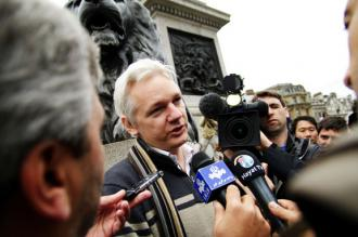 Julian Assange speaking with reporters at an antiwar demonstration in Trafalgar Square